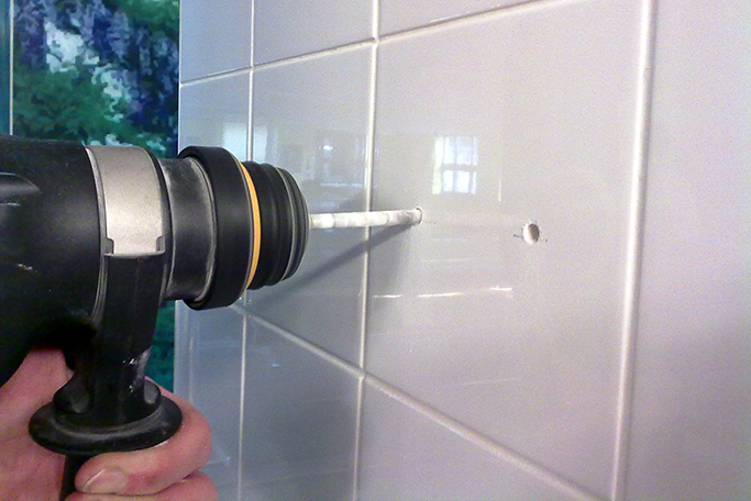 video how to set out drill holes in tiles for pipework tile mountain. Black Bedroom Furniture Sets. Home Design Ideas