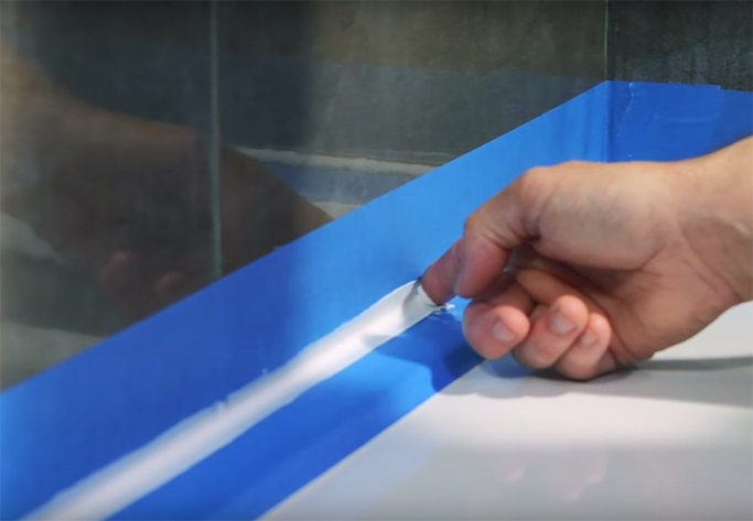 the easiest way to silicone a bath or shower tray tile